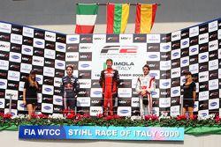 Second placed Mirko Bortolotti, race winner Kazim Vasiliauskas and third place finisher Andy Soucek celebrate on the podium