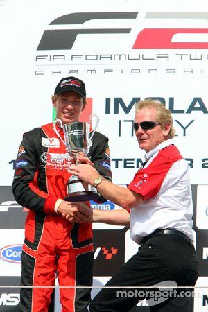 Race winner Kazim Vasiliauskas celebrates on the podium with Jonathan Palmer Motorsport Vision Chief Executive