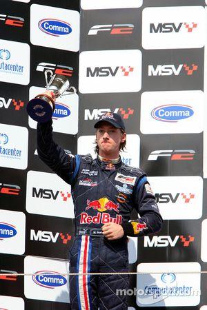 Second place finisher Mirko Bortolotti celebrates on the podium