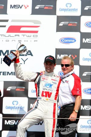 Andy Soucek celebrates third place and the Championship win ion the podium with Jonathan Palmer Motorsport Vision Chief Executive