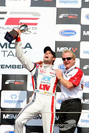 Andy Soucek celebrates third place and the Championship win ion the podium with Jonathan Palmer Moto
