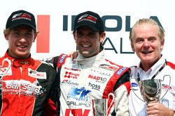 Race winner Kazim Vasiliauskas and third place finisher Andy Soucek celebrate on the podium with Jonathan Palmer Motorsport Vision Chief Executive