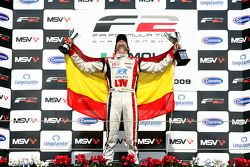 Andy Soucek celebrates third place and the Championship win on the podium
