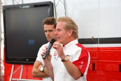 Andy Soucek and Jonathan Palmer Motorsport Vision Chief Executive talk to guests in Hospitality