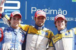 Luca Filippi celebrates his victory on the podium with Sergio Perez and Javier Villa