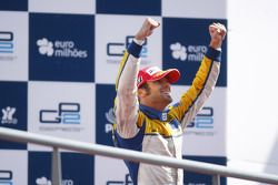 Luca Filippi celebrates his victory on the podium