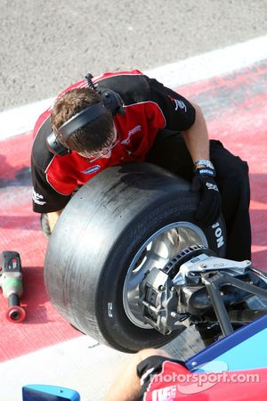 Mechanic changes wheel for Armaan Ebrahim
