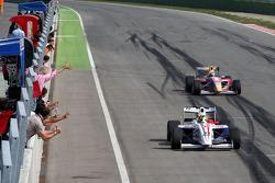 Race winner Andy Soucek crosses the line