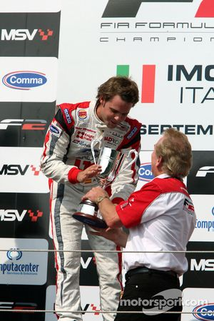 Race winner Andy Soucek celebrates on the podium with Jonathan Palmer Motorsport Vision Chief Execut