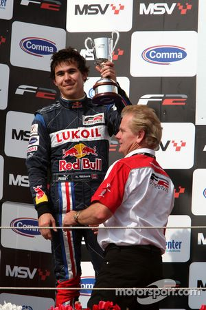 Second placed Robert Wickens celebrates on the podium with Jonathan Palmer Motorsport Vision Chief E