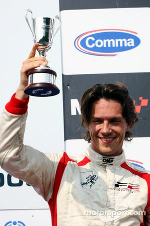 Third placed Milos Pavlovic celebrates on the podium