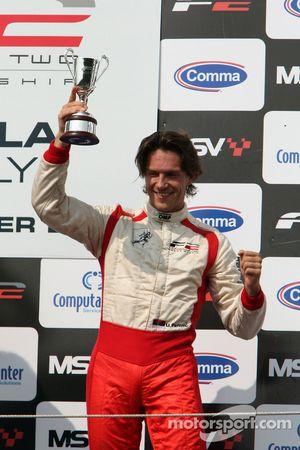 Third place finisher Milos Pavlovic celebrates on the podium