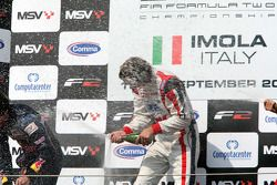 Podium: Second place Robert Wickens and race winner Andy Soucek celebrate and spray the champagne on