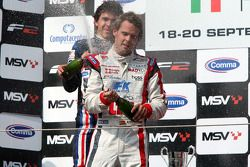 Podium: Second place Robert Wickens and race winner Andy Soucek celebrate and spray the champagne on the podium