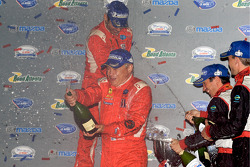 GT2 podium: Mika Salo and Jaime Melo celebrate with champagne