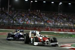 Jarno Trulli, Toyota Racing leads Nico Rosberg, WilliamsF1 Team