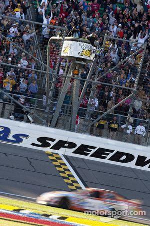 Joey Logano takes the checkered flag