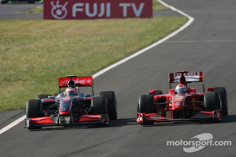 Heikki Kovalainen, McLaren Mercedes und Giancarlo Fisichella, Scuderia Ferrari