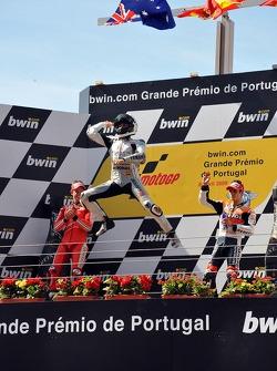 Podium: race winner Jorge Lorenzo, Fiat Yamaha Team celebrates with second place Casey Stoner, Ducat