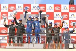 GT1 podium: class and overall winners Enrique Bernoldi and Roberto Streit, second place Miguel Ramos and Alex Müller, third place Bert Longin and James Ruffier