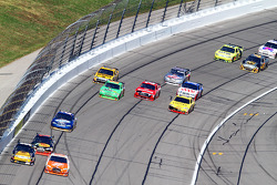 Erik Darnell, Hall of Fame Racing Ford and Joey Logano, Joe Gibbs Racing Toyota lead a group of cars