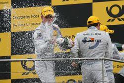 Podium: champagne for Paul di Resta, Team HWA AMG Mercedes C-Klasse