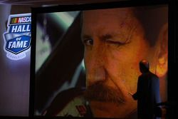 NASCAR Vice President of Corporate Communications Jim Hunter watches a video of Dale Earnhardt after