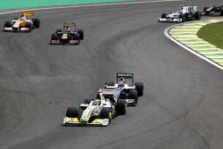Jenson Button, BrawnGP leads Kazuki Nakajima, Williams F1 Team