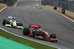 Heikki Kovalainen, McLaren Mercedes y Jenson Button, Brawn GP
