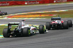 Jenson Button, Brawn GP y Kamui Kobayashi, Toyota F1 Team