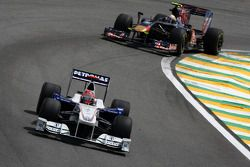 Robert Kubica, BMW Sauber F1 Team leads Sebastien Buemi, Scuderia Toro Rosso
