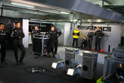 Mechanics waiting in the pitbox while the cars are out on the track