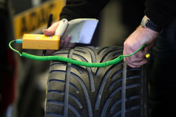 Dunlop mechanic checking the tyre temperature