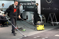 Mercedes Benz teammember cleaning the garage