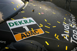 The championship winning car of Timo Scheider, Audi Sport Team Abt Audi A4 DTM covered in champagne