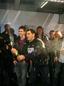 Hans-Jurgen Abt, Teamchef Abt-Audi, spraying champagne in the Abt Audi pitbox