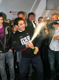 Hans-Jurgen Abt, Teamchef Abt-Audi spraying champagne in the Abt Audi pitbox