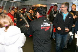 Hans-Jurgen Abt, Teamchef Abt-Audi spraying champagne over Siegfried Krause, Commercial Manager Audi