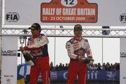 Podium: les vainqueurs et champions 2009 Sébastien Loeb et Daniel Elena fêtent le titre avec l'équip