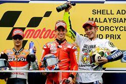 Podium: 1. Casey Stoner, 2. Dani Pedrosa, 3. und Weltmeister Valentino Rossi