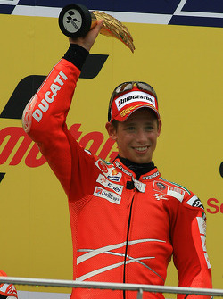 Podio: ganador de la carrera Casey Stoner, Ducati Marlboro Team