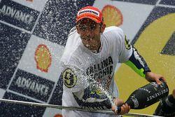 Podium: third place and 2009 MotoGP champion Valentino Rossi, Fiat Yamaha Team celebrates with champagne