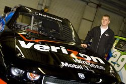 Justin Allgaier stands with the Verizon Wireless Dodge Challenger Nationwide Car of Tomorrow