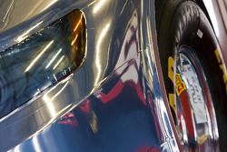 The number 12 Dodge Challenger Nationwide Car of Tomorrow is reflected in the Toyota Camry Car of To
