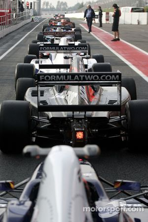 Cars lined up in the pitlane