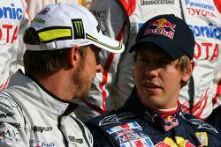 Jenson Button, Brawn GP et Sebastian Vettel, Red Bull Racing