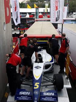 F2 Mechanics load the car of Alex Brundle into the trucks