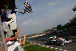 Race winner Andy Soucek crosses the line to win the race
