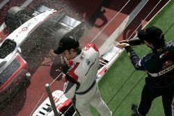 Race winner Andy Soucek celebrates with Robert Wickens on the podium