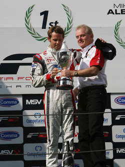 Jonathan Palmer Motorsport Vision Chief Executive presents 2009 F2 Champion Andy Soucek with his Cha